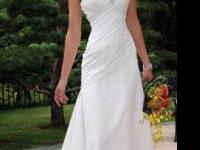 New wedding dress. Never worn. Size 8. All White Asking
