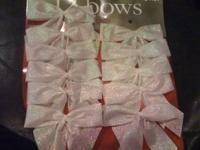 White & silver bows, pictured below. Pre-made. Made out