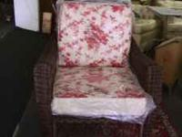 Brand new wicker chair with cushions still in the