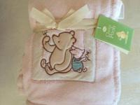 Brand brand-new pale pink Winnie The Pooh blanket in