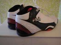 Never been worn women's Fila basketball sneakers. Size