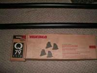 I am selling a new Yakima rack system it was used once