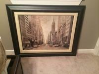 Antique color art of New York with black frame. In