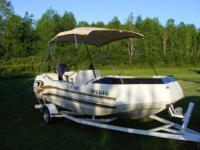 1996 Sylvan Deck Boat tri hull. Wide and stable but