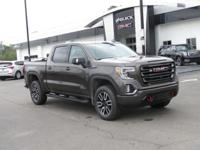 This Sierra has level kit, upgraded tires, tool box and
