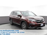 This outstanding example of a 2019 Honda Pilot Touring