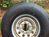 NEW, NEVER USED, MOUNTED AND BALANCED TRAILER TIRE,