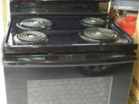 New Black GE self cleaning stove, only used twice and