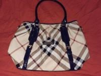 For sale Burberry handbag, I'm not sure if it is real.