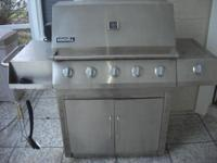 Stainless Steel Gas Grill with side burner. Works well