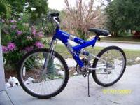 Brand new,Hardly ridden.Duel-suspension,rugged mountain