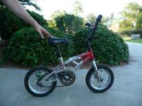 Great starter bike. Has hand and pedal brakes, some