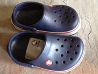 These are a pair of NIB boys crocs size 1. They are