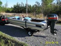 13 ft. 1980's boat and motor. Shelter kept !! She get's