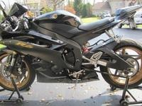 You are viewing a very nice 2006 Yamaha YZF R6 with low