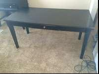 Nice almost black desk with drawer. Ashley brand.