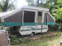 This is still a nice a clean well kept camper. Has AC