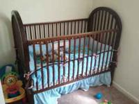 Very nice dark wood baby crib. comes with everything