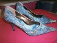 size 91/2 dark and light blue with silver designs on it