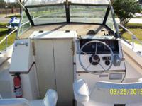 "This boat is 20' 7"" long, good trailer, has cubby cabin"