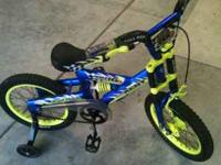 BOYS BIKE IN GREAT SHAPE 12 OR 14 INCH WITH TRAINING