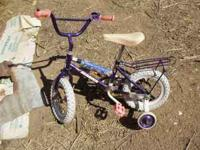FOR SALE: Nice kids bike, has both training wheels,