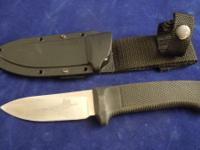 Nice hunting knife made by Cold Steel.  (leave message)