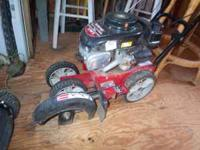 Gas edger, runs and works great. Does have a lever