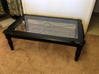 For sale is a huge wood and glass coffee table. It has