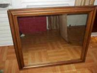 Very nice sturdy mirror weighs about 30-35 pounds,no