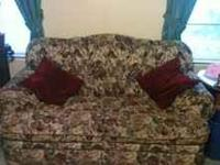 Living room set, sofa and love seat. Burgundy floral