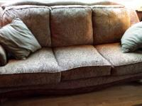 Nice couch with wooden trim, 80 inches, muted greens,