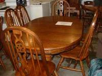 Nice solid wood, Oak Table with 6 chairs & one leaf,
