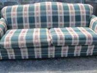 I have a green and red plaid sofa for sale for $100 in