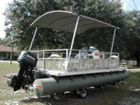 Nice 20 ft pontoon boat.  50 horse Mercury rebuilt 1