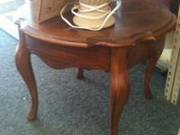 THIS IS A VERY PRETTY SIDE TABLE. GREAT FOR ANY ROOM IN