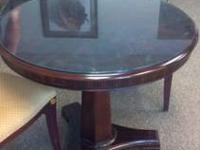 This is a very nice round wood side table. We have