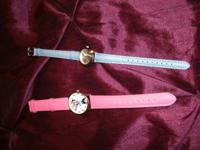2 girls disney watches. a pink leather band with daisy.
