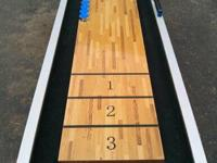 Almost new shuffleboard table. It looks and works great