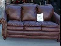 Nice newer leather bond sofa. Brown tone. Sofa is like