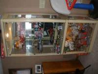 large upright display cabinet. it does have lights that