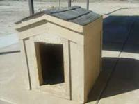 This is a real nice wood dog house. It was built to