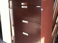 Two used wood filing cabinets for sale.They have minor
