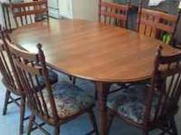 Nice wooden table in great condition with 6 chairs.