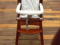 This is a wooden safety 1st high chair .it has a