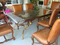 Very nice wooden table with 6 leather chais for sale