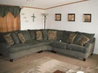 Large and comfortable pillow back sectional sofa. Takes
