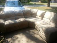 Selling used sectional couch. There is a tear in one of