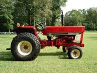 I MUST SELL MY IH 284 GAS TRACTOR AT A LOW BALL PRICE.