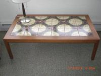 Offered is a vintage end table with ceramic tile